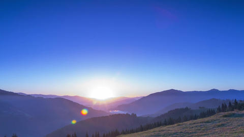 Sunrise in the Cloudless Sky over the Mountains. Time Lapse Footage