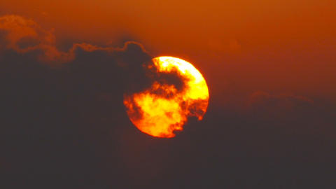 great sun rising between clouds, telephoto lens Footage