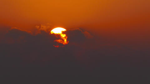 sun rising in clouds, telephoto, timelapse, 4k Live Action