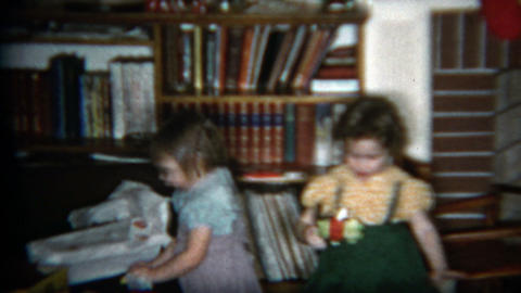 1960: Heartwarming girl gives baby brother toy from gift Footage