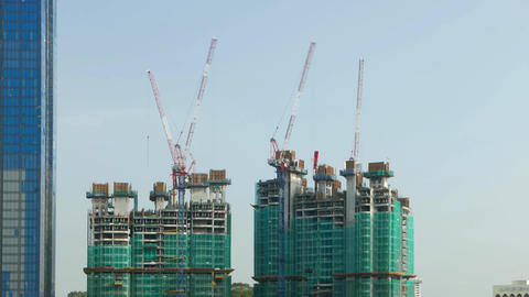 Modern building, twin towers under construction, concrete frame, time lapse Footage