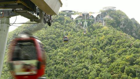 Langkawi gondola lift move away against woody slope, time lapse shot Footage