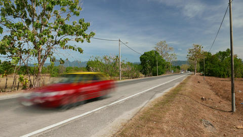 Sparse traffic rush at rural road, tropical island environment, time lapse shot Live Action