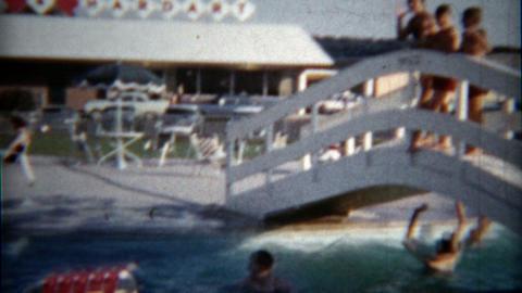 1960: Hotel lodge outdoor swimming pool courtyard hot summer fun Footage