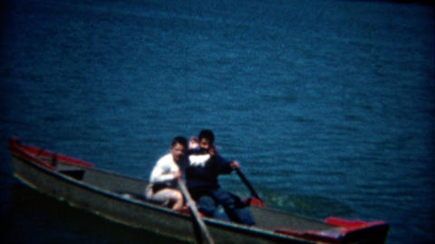 1960: Boys paddling off the rowboat by themselves for the first time Footage