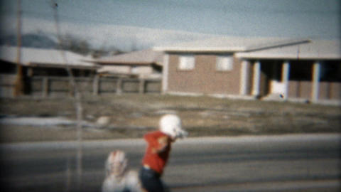 1957: Small children playing tackle football in suburban Denver, Colorado area Footage