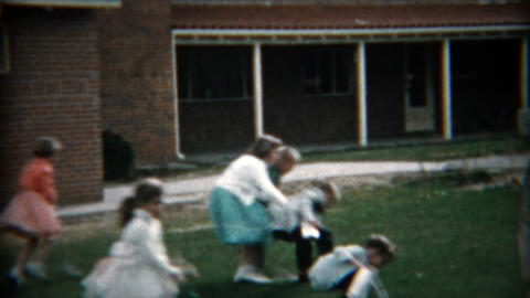 1957: Mad dash Easter egg hunt from ravenously formal dressed children Footage