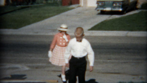 1957: Group of kids dressed up for Easter showing off in neighborhood Footage