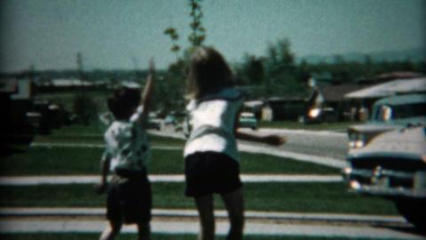 1961: New family car pulls into driveway for inspection by excited family Footage