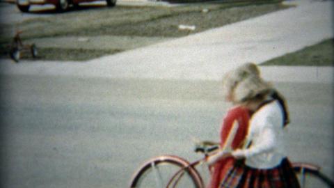 1957: Boy riding bike to meetup with family and boyhood pals ビデオ