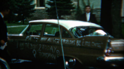1958: Newlyweds escaping the church in a just married car Live Action