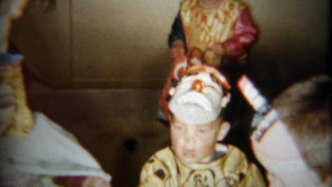 1959: Kids wearing creepy clown Halloween costumes go trick or treat Footage