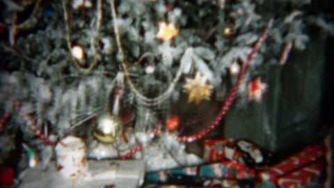 1955: Christmas tree tilt up with bountiful gifts ornaments and glitter Footage