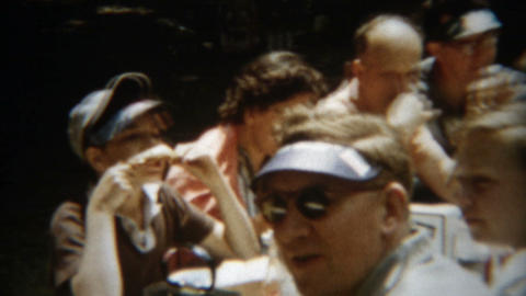 1955: Outdoor family picnic with visor hats popularly worn by young and old alik Footage