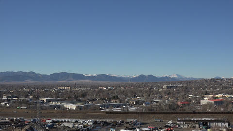 Timelapse busy highway on clear day view of front range Denver area mountains Footage