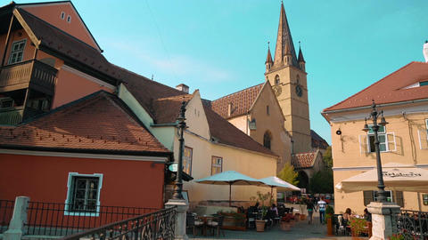 Static shot showing a young couple strolling through the streets of Sibiu, Trans Footage