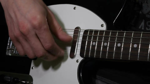 Touch the strings. Strumming Footage