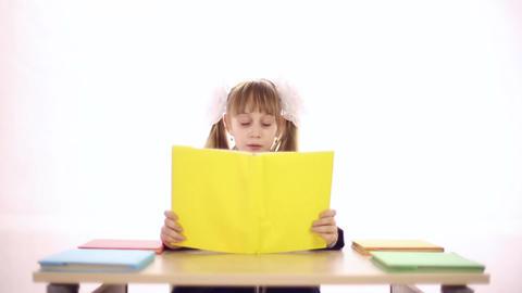 Schoolgirl reads a textbook Footage