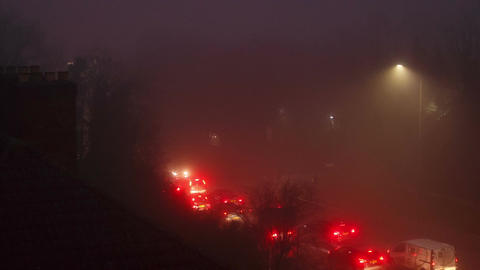 Timelapse of car traffic flowing under extreme fog conditions Footage