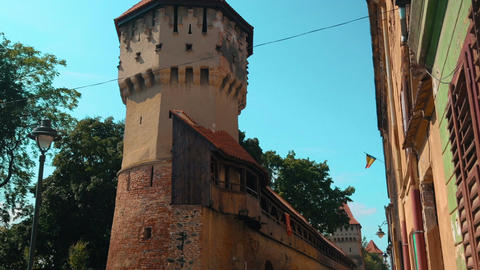 Tilting shot showing medieval ruins of a watch tower in the town of Sibiu, Trans Footage