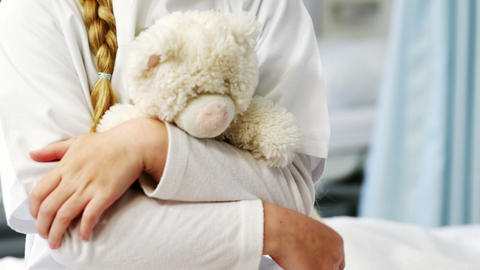 Mid section of girl holding teddy bear Live Action