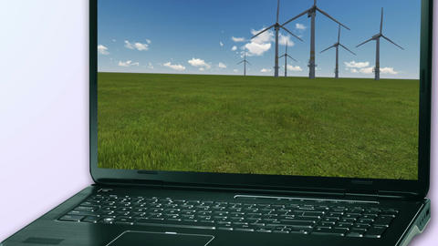 Windmills Generators in field on notebook computer made with ae cs5 software Animation