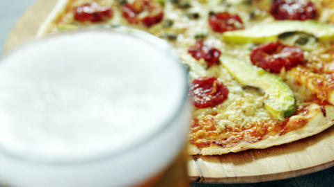 Delicious pizza with a glass of beer Live Action