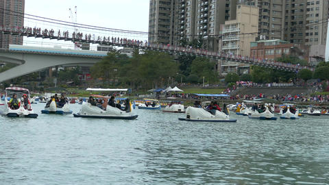 People enjoying Pedalboats on lake in Bitan New Taipei Cit 05 Footage