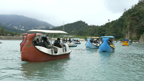 People enjoying Pedalboats on lake in Bitan New Taipei Cit04 Footage
