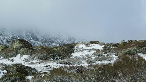 Telephoto panning shot of a wintry landscape in Serra da Estrela, Covilha, Portu Footage