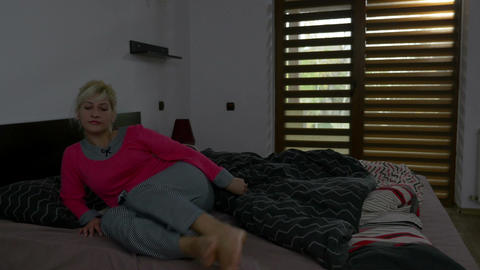 Girl wakes up and starts morning routine before getting out of bed Footage