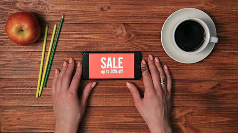 Girl holding smartphone with sale ad on screen Footage