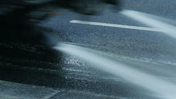 4K Ungraded: Watering Machine Washes Streets of City With Sprinkler Footage