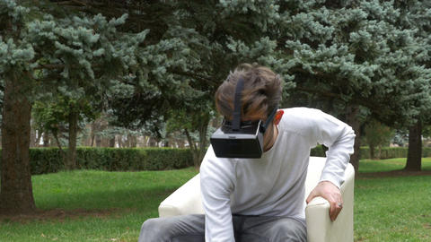 Student watching 3d multimedia content through the lens on virtual reality glass Footage