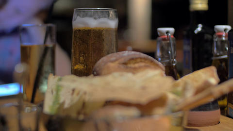 Beer and bread in cafe 画像