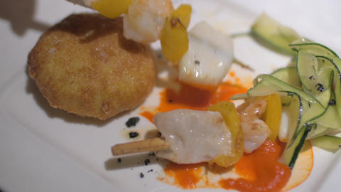 Eating restaurant dish with seafood skewers and meat croquette Footage