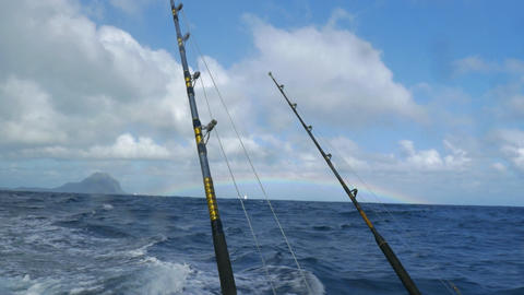 Fishing rods on sailing motor boat Live Action