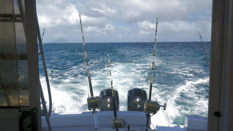 Yachts with fishing tackles sailing in ocean Footage