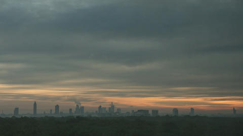 Timelapse of sun rising in overcast sky over the city Footage