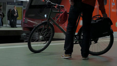 Man with bike waiting for subway train Footage