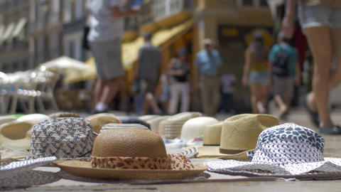 Bottom view of summer sun hats that is selling on the market, Valencia, Spain Image