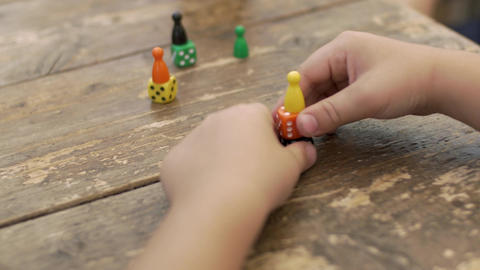 Child playing with dice and counters Footage