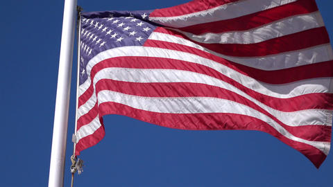 Two videos of United States flag waving in the wind in 4K Footage