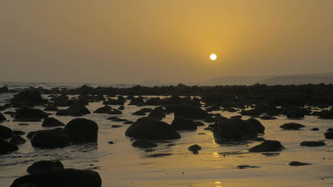 Coast with rocks at sunset Footage
