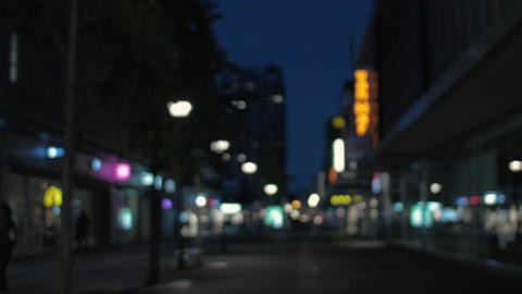 Defocused shot of night street with illuminated banners Footage