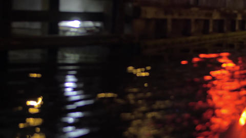 Close up view of river wave on moving boat at night, Amsterdam, Netherlands Live Action