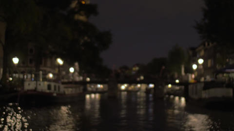 View to night Amsterdam with canal and bridge ビデオ