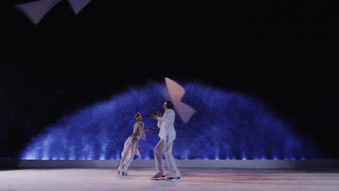 Couple with kites dancing on the ice Footage