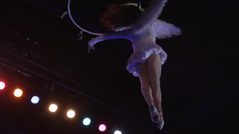 Woman acrobat performing with neck loop in the air Footage