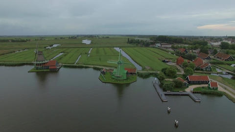 Aerial shot of old windmills and fields in Netherlands Footage